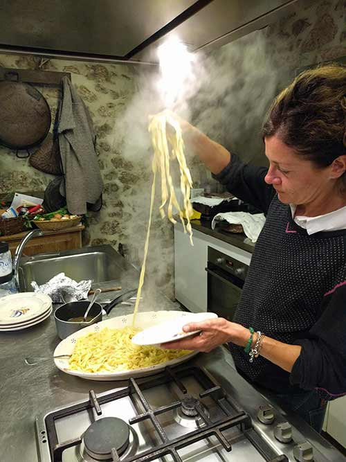 francesca plating pasta at black truffle lodge