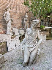 half naked woman statue picture
